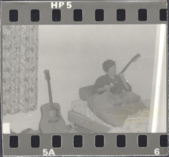 Neil Rigby playing Hondo guitar in bed with Eko 12 string